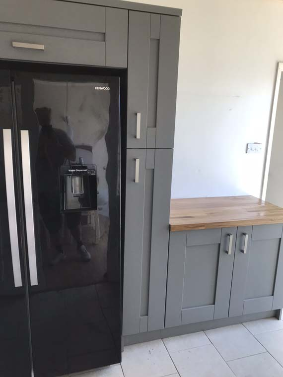 Kitchen fridge and cupboards